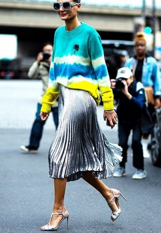 How to wear: light blue sunglasses, silver leather heeled sandals, silver pleated midi skirt, multi colored tie-dye crew-neck sweater