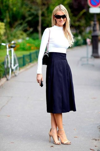 How to wear: black leather clutch, beige leather heeled sandals, navy pleated midi skirt, white turtleneck