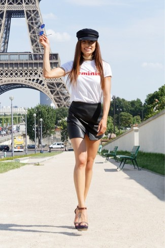 How to wear: black flat cap, dark brown leather heeled sandals, black leather mini skirt, white and red print crew-neck t-shirt