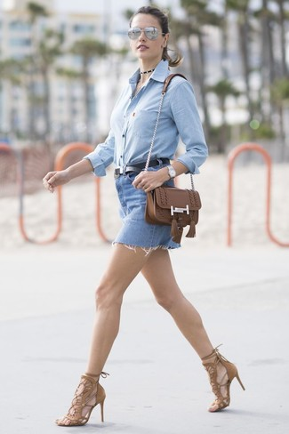 Alessandra Ambrosio wearing Brown Leather Crossbody Bag, Brown Suede Heeled Sandals, Blue Denim Mini Skirt, Light Blue Chambray Dress Shirt