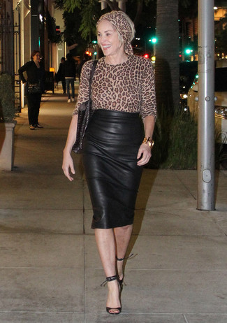 How to wear: black leather tote bag, black leather heeled sandals, black leather pencil skirt, tan leopard long sleeve blouse