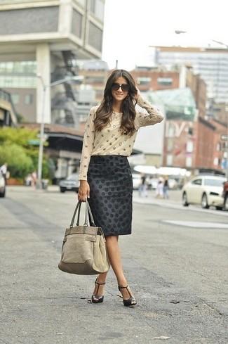 How to wear: beige suede tote bag, black leather heeled sandals, black polka dot pencil skirt, beige embellished long sleeve t-shirt