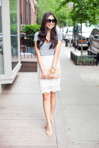 How to wear: beige leather clutch, beige leather heeled sandals, white lace pencil skirt, grey v-neck t-shirt