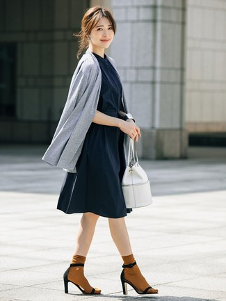 How to wear: white leather bucket bag, black suede heeled sandals, navy shirtdress, grey open cardigan