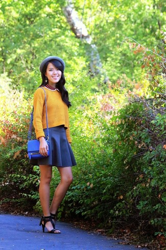 How to wear: blue leather crossbody bag, black leather heeled sandals, navy skater skirt, yellow knit cropped sweater