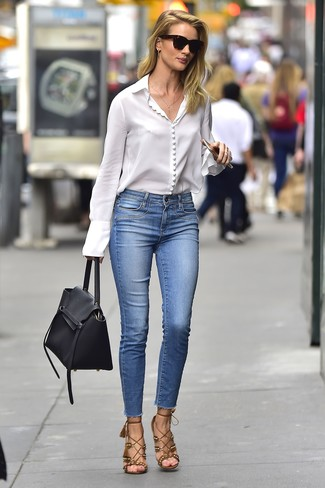 How to wear: black leather satchel bag, brown suede heeled sandals, blue skinny jeans, white button down blouse