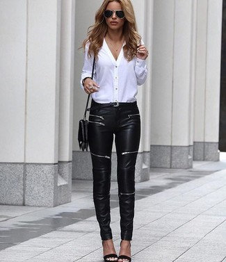 How to wear: black leather crossbody bag, black leather heeled sandals, black leather skinny jeans, white button down blouse