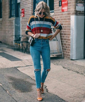 How to wear: black leather crossbody bag, orange suede heeled sandals, blue ripped skinny jeans, multi colored horizontal striped crew-neck sweater
