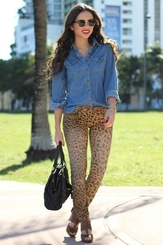 How to wear: black leather tote bag, brown leather heeled sandals, khaki leopard skinny jeans, blue denim shirt