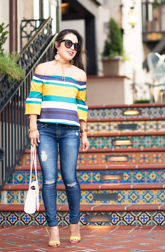 How to wear: white leather crossbody bag, yellow leather heeled sandals, blue ripped skinny jeans, multi colored horizontal striped off shoulder top
