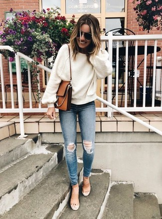 How to wear: brown leather crossbody bag, tan leather heeled sandals, blue ripped skinny jeans, white oversized sweater