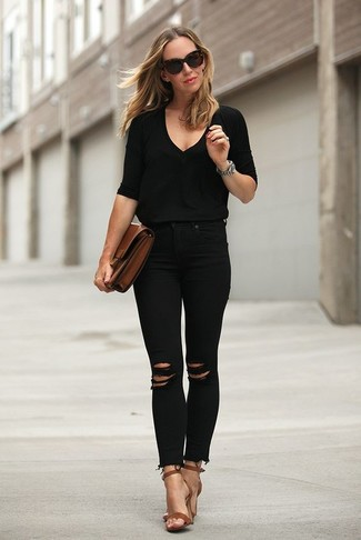 How to wear: brown leather clutch, brown leather heeled sandals, black ripped skinny jeans, black v-neck sweater