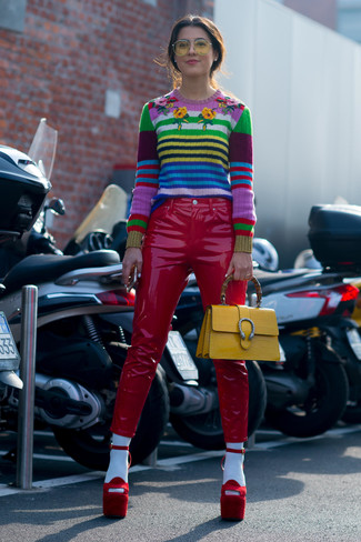How to wear: yellow leather satchel bag, red suede heeled sandals, red leather skinny pants, multi colored horizontal striped crew-neck sweater