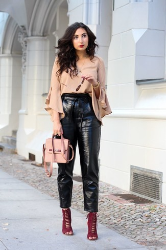 How to wear: pink leather crossbody bag, burgundy suede heeled sandals, black leather tapered pants, beige ruffle long sleeve blouse