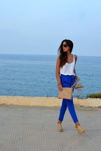 How to wear: tan suede clutch, beige leather heeled sandals, blue tapered pants, white tank