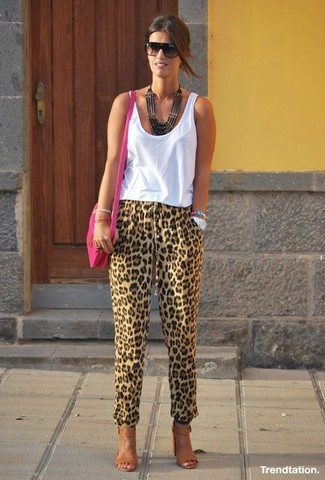 How to wear: hot pink leather crossbody bag, brown leather heeled sandals, tan leopard tapered pants, white tank