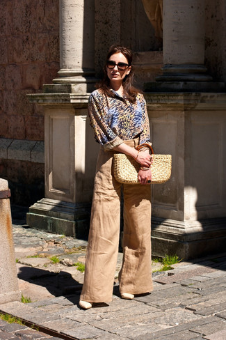 How to wear: beige straw tote bag, beige leather heeled sandals, tan wide leg pants, tan leopard dress shirt