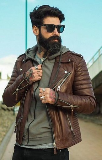 How to wear: black skinny jeans, grey henley shirt, olive hoodie, brown leather biker jacket