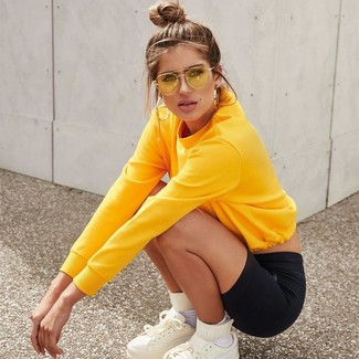 How to wear: white socks, white leather high top sneakers, black bike shorts, yellow sweatshirt