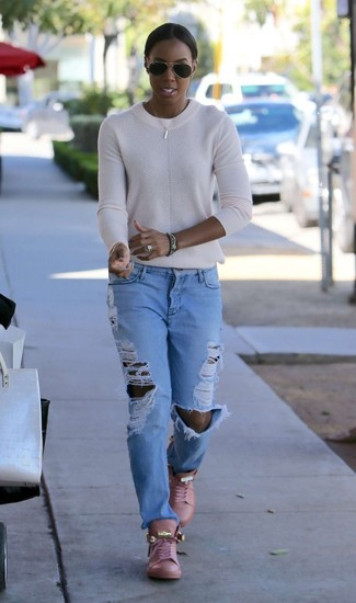 How to wear: black sunglasses, pink leather high top sneakers, light blue ripped boyfriend jeans, white crew-neck sweater