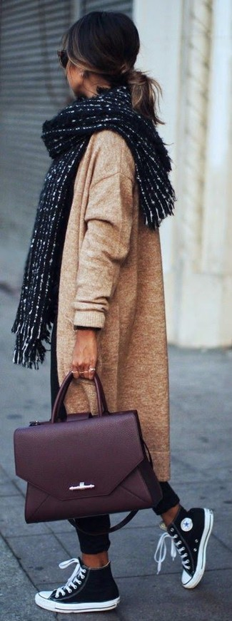 How to wear: burgundy leather satchel bag, black and white canvas high top sneakers, black chinos, camel knit coat