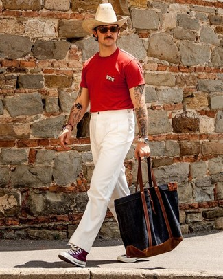 How to wear: navy canvas tote bag, purple canvas high top sneakers, white chinos, red crew-neck t-shirt