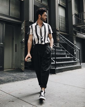 How to wear: black sunglasses, black canvas high top sneakers, black chinos, black and white vertical striped short sleeve shirt