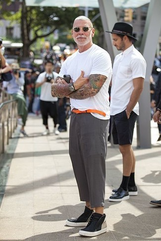 How to wear: orange leather belt, black leather high top sneakers, grey linen dress pants, white crew-neck t-shirt