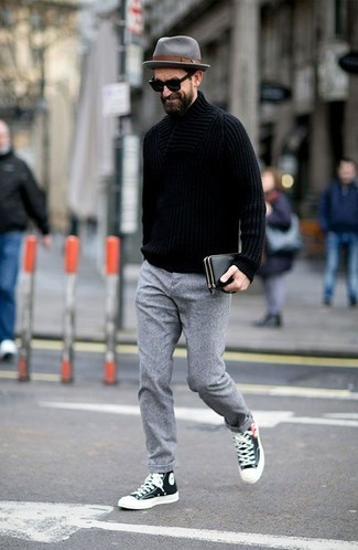 How to wear: grey wool hat, black and white high top sneakers, grey wool dress pants, black knit turtleneck