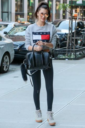 How to wear: black leather satchel bag, grey suede high top sneakers, black leggings, grey print sweatshirt