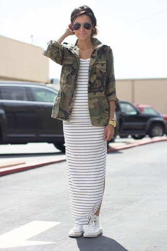 How to wear: black sunglasses, white high top sneakers, white and navy horizontal striped maxi dress, olive camouflage military jacket