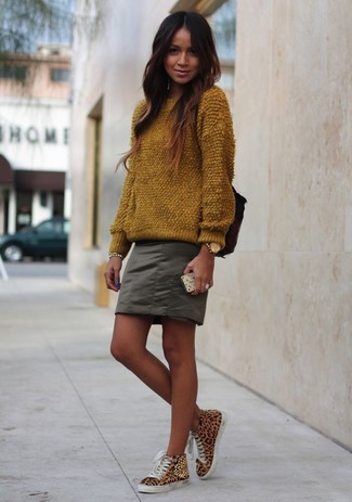 How to wear: gold watch, tan leopard high top sneakers, olive mini skirt, brown fluffy crew-neck sweater