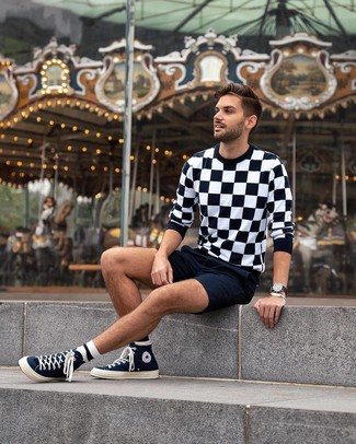 How to wear: black leather watch, navy canvas high top sneakers, navy shorts, black and white check crew-neck sweater