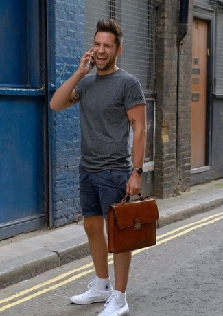 How to wear: tobacco leather messenger bag, white canvas high top sneakers, navy shorts, charcoal crew-neck t-shirt