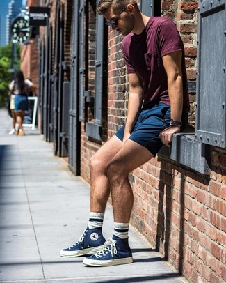 How to wear: black sunglasses, navy canvas high top sneakers, navy shorts, burgundy crew-neck t-shirt