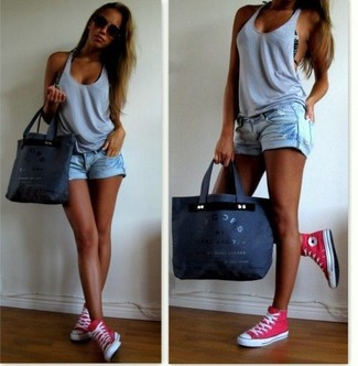 How to wear: charcoal canvas tote bag, hot pink high top sneakers, light blue ripped denim shorts, grey tank