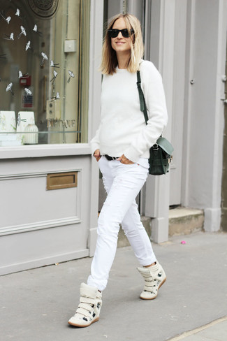 How to wear: black leather crossbody bag, white leather high top sneakers, white ripped skinny jeans, white crew-neck sweater