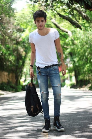 How to wear: black canvas backpack, black leather high top sneakers, blue ripped skinny jeans, white crew-neck t-shirt
