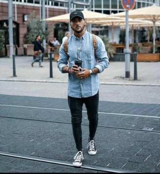 How to wear: brown leather backpack, black and white canvas high top sneakers, black skinny jeans, light blue denim jacket