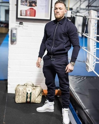 How to wear: beige leather tote bag, white leather high top sneakers, navy sweatpants, navy bomber jacket