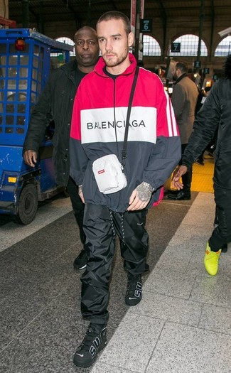 How to wear: white fanny pack, black leather high top sneakers, black sweatpants, red and black hoodie