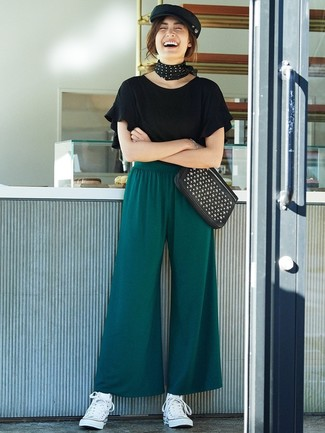 How to wear: black studded leather clutch, white canvas high top sneakers, dark green wide leg pants, black ruffle crew-neck t-shirt