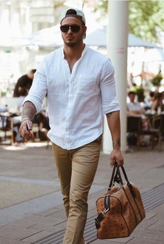How to wear: white baseball cap, brown leather holdall, beige dress pants, white long sleeve shirt