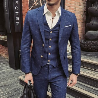 How to Wear a Navy Three Piece Suit: A navy three piece suit and a white long sleeve shirt are certainly worth being on your list of true menswear staples.