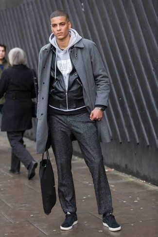 How to Wear Charcoal Chinos: Pair a grey overcoat with charcoal chinos to pull together an interesting and put together outfit. Finish off with black suede low top sneakers to transform this outfit.