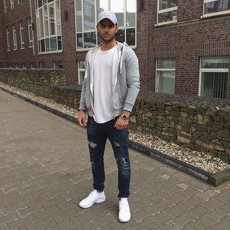 How to wear: grey hoodie, white crew-neck t-shirt, navy ripped jeans, white athletic shoes