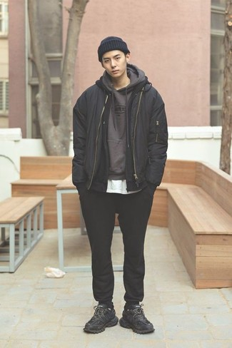 Men's Looks & Outfits: What To Wear In a Relaxed Way: A black bomber jacket and black sweatpants are the kind of a tested casual combination that you need when you have zero time to dress up. Put a more relaxed spin on this outfit by slipping into black athletic shoes.