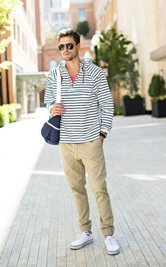 How to wear: white and navy horizontal striped hoodie, red tank, beige chinos, white canvas low top sneakers
