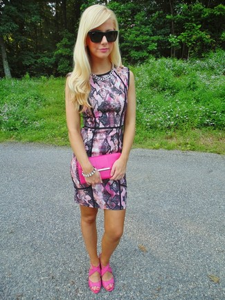 How to wear: black sunglasses, hot pink leather clutch, hot pink leather heeled sandals, pink snake bodycon dress