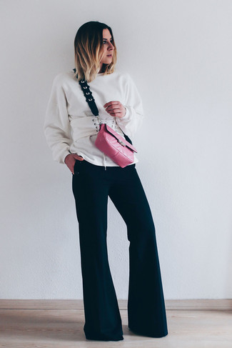 How to wear: white leather waist belt, hot pink leather crossbody bag, black flare pants, white sweatshirt